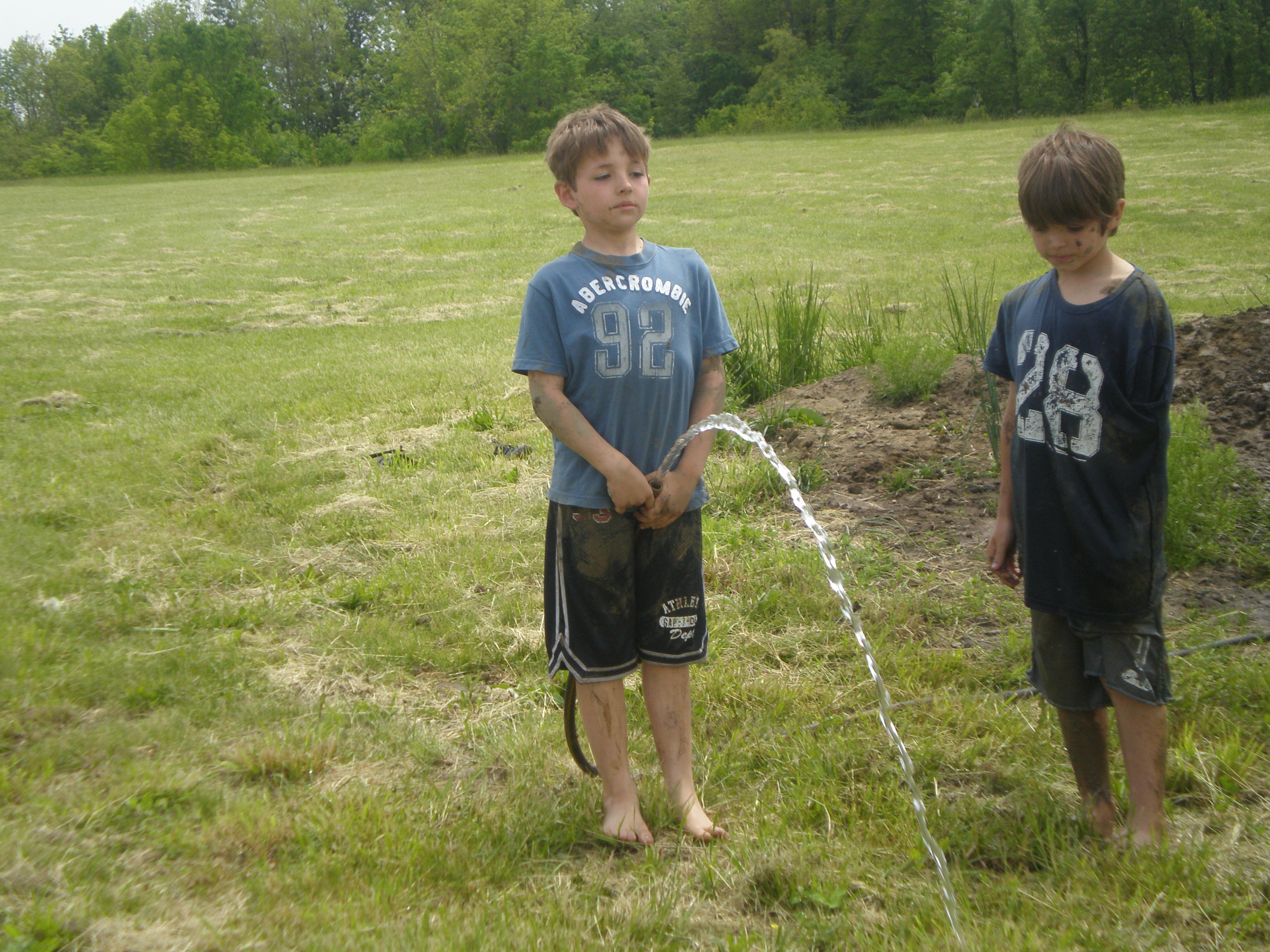 Peeing through a hose