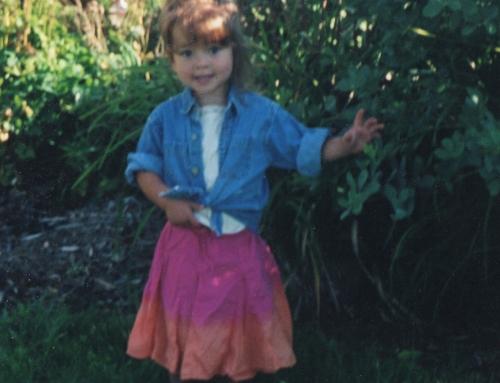 Lisa in dress by flowers